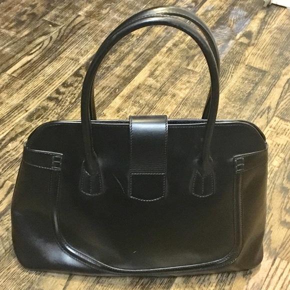 2b6bd5c5290 Tod's Black Leather Purse. M_5be1006e81bbc8e444c9eac9